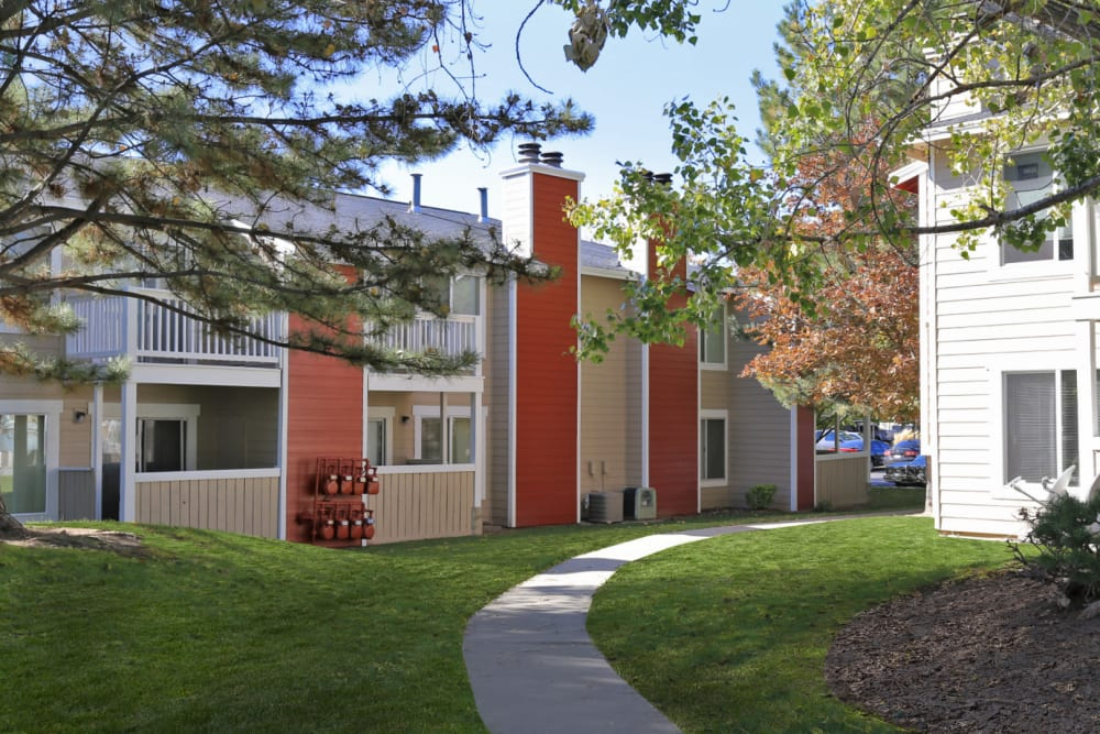 Well-maintained landscaping outside resident buildings at Overlook Point Apartments in Salt Lake City, Utah