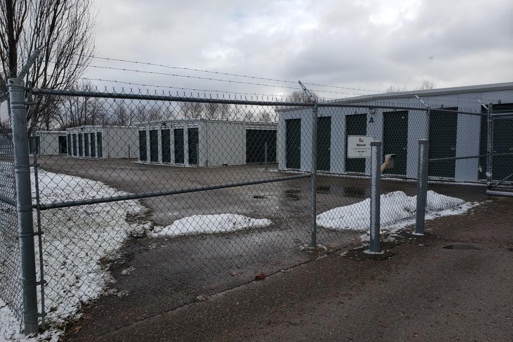 The gate at Apple Self Storage - Midland in Midland, Ontario