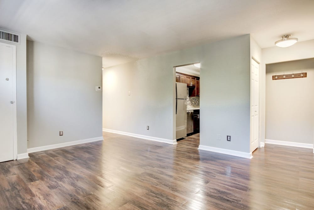 Open-concept layout with hardwood floors in a model home at Heritage at Shaw Station in Washington, District of Columbia