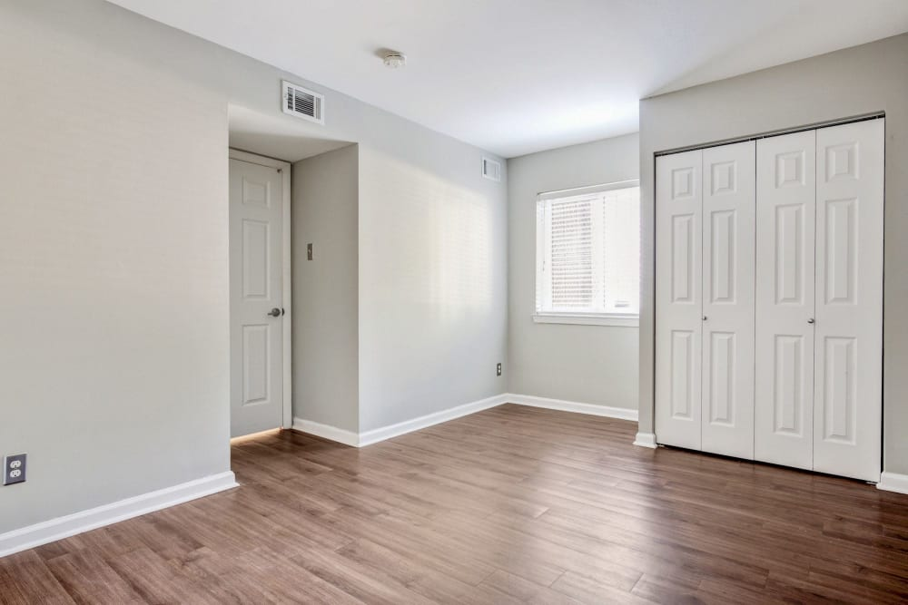 Bedroom with hardwood flooring and plenty of natural light in a model home at Heritage at Shaw Station in Washington, District of Columbia