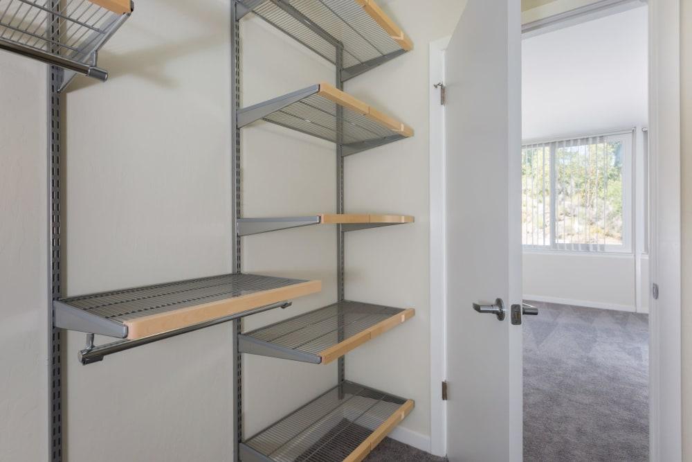 Huge walk-in closet with plenty of shelving in a model home at Sofi Belmont Glen in Belmont, California