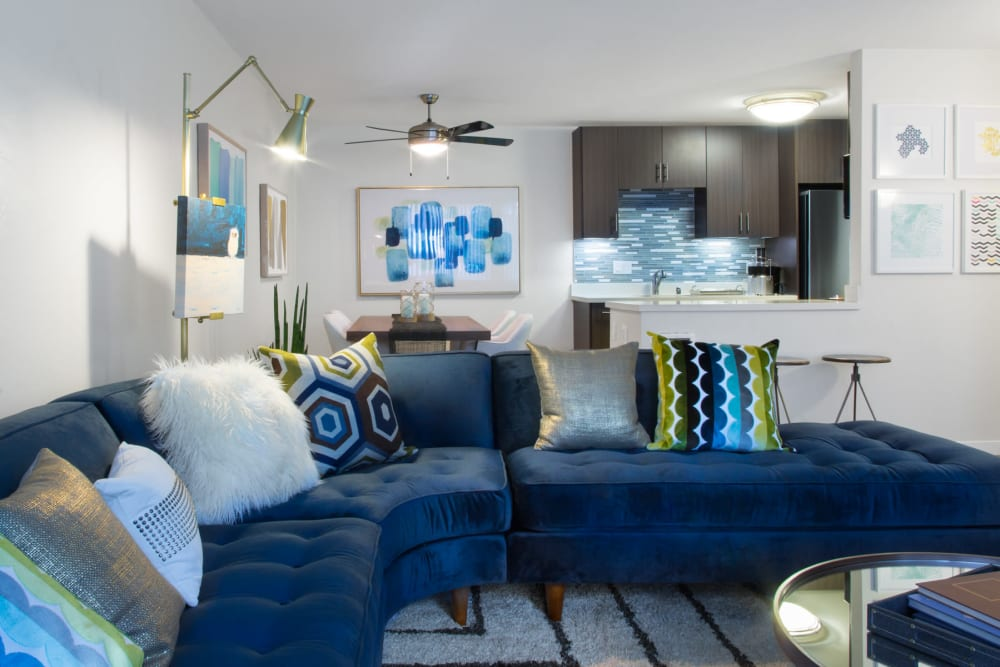 Well-decorated living space in the open-concept floor plan of a model home at Sofi Belmont Glen in Belmont, California