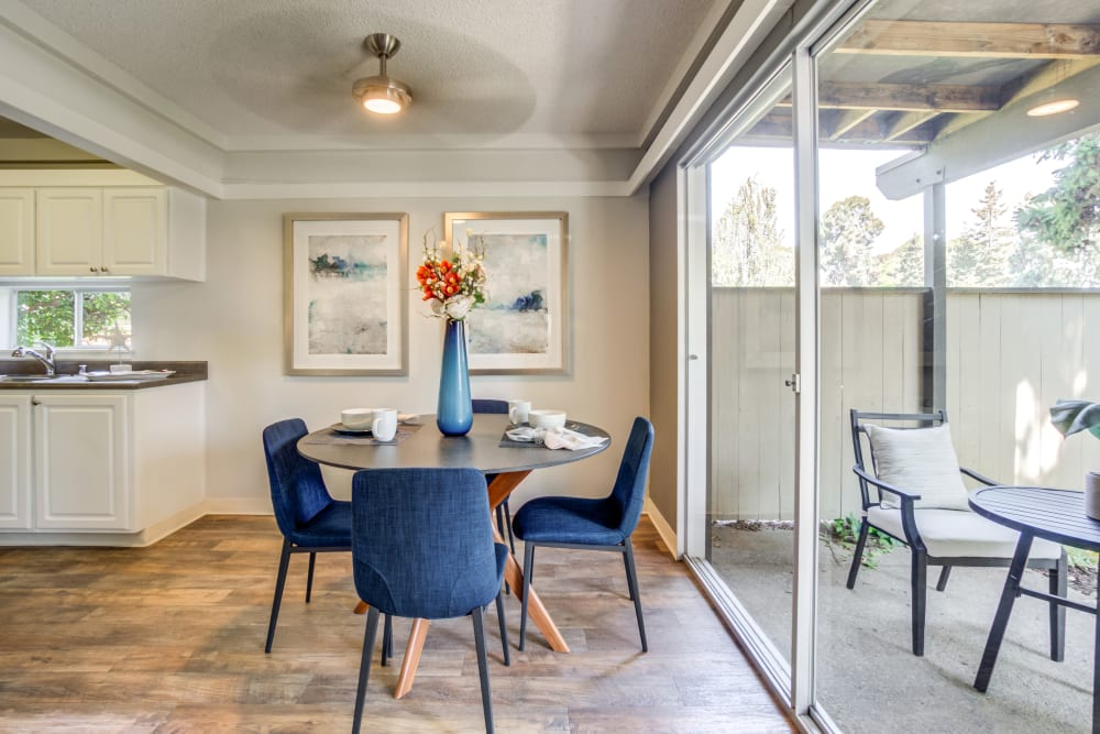 Dining area with hardwood flooring and a ceiling fan in a model home at Sofi Fremont in Fremont, California