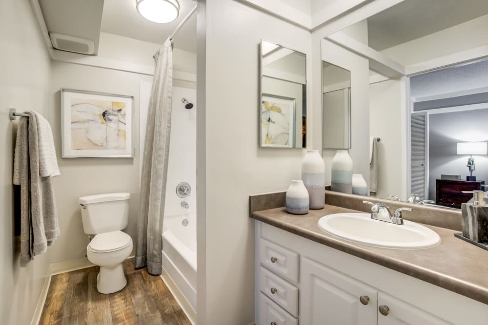 Large vanity mirror and a quartz countertop in a model home's bathroom at Sofi Fremont in Fremont, California