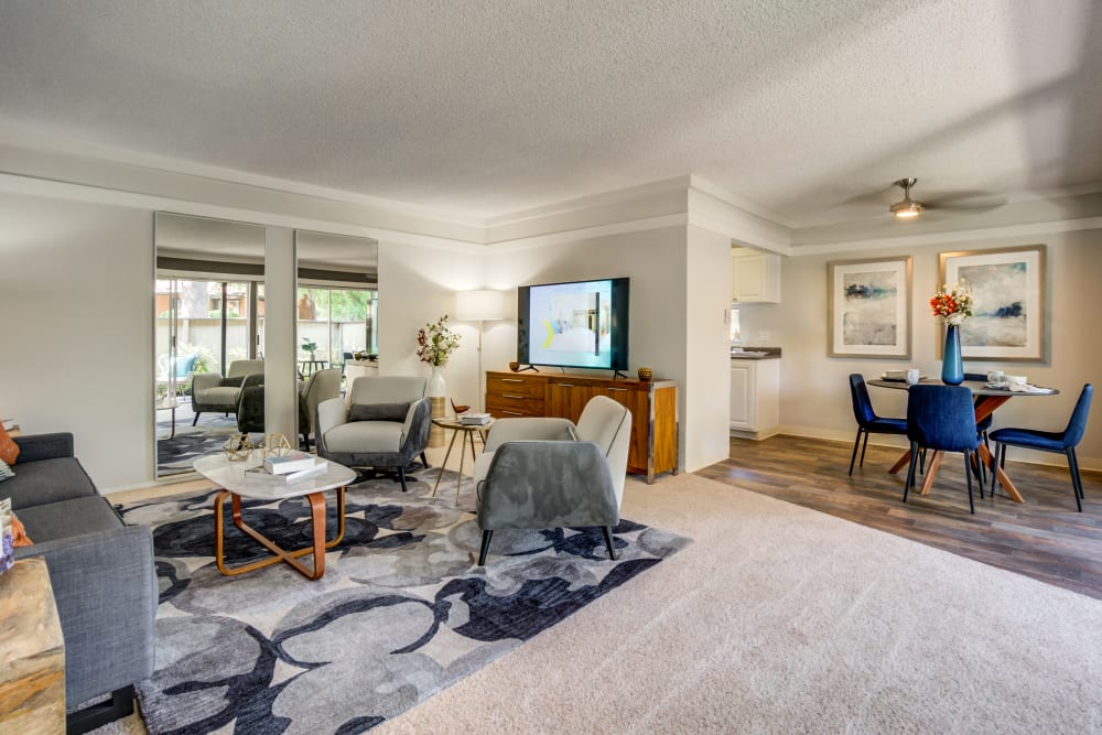 Beautifully decorated living space with plush carpeting in the open-concept floor plan of a model home at Sofi Fremont in Fremont, California