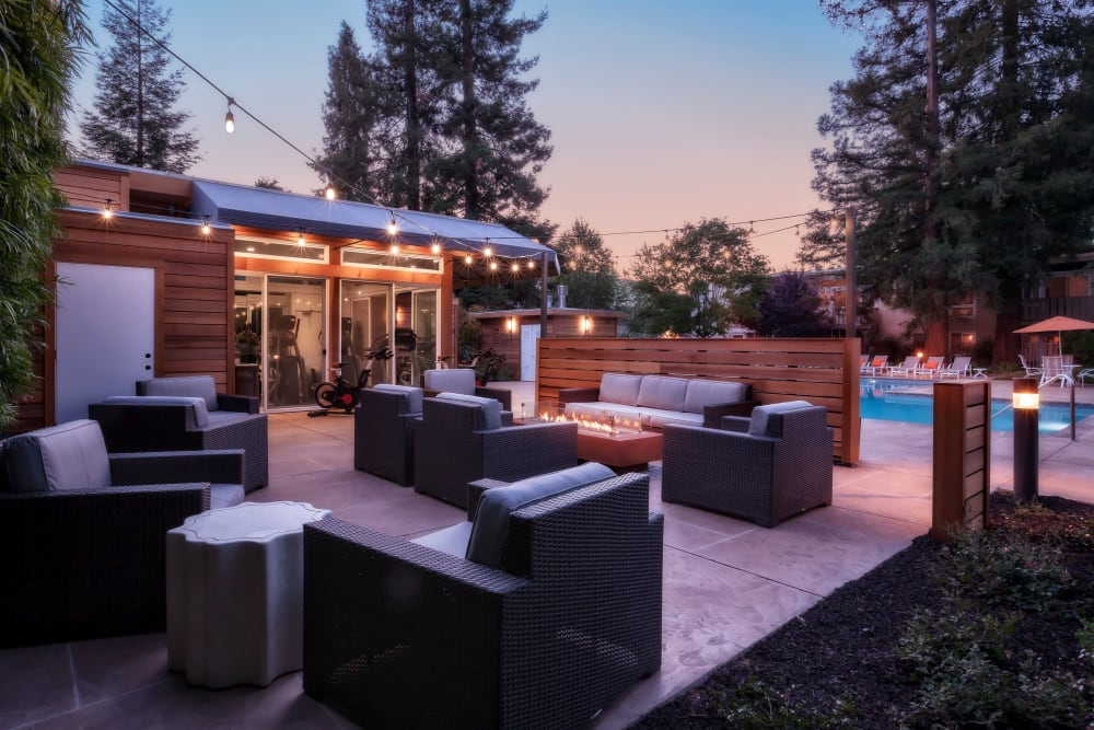 Outdoor lounge with fireplace at Brookdale Apartments in San Jose, California