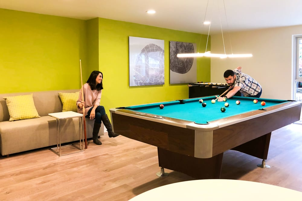 Resident playing billiards at Greendale Apartments in Mountain View, California