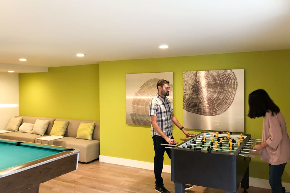 Residents playing foosball at Greendale Apartments in Mountain View, California