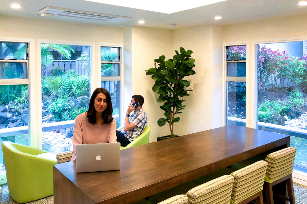 Residents working in the co-work space at Greendale Apartments in Mountain View, California