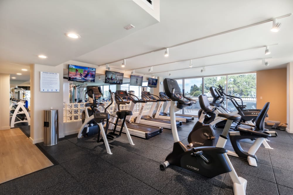 Fully-equipped fitness center at Hillsborough Plaza Apartments in San Mateo, California