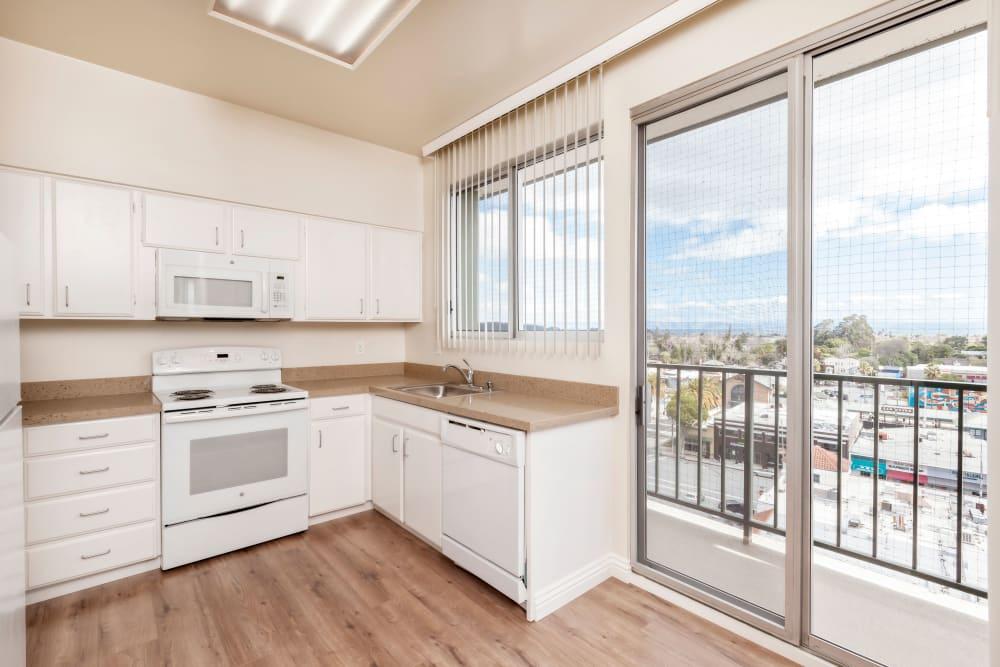 Bright, spacious kitchen at Hillsborough Plaza Apartments in San Mateo, California