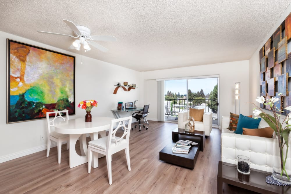 Living room with a ceiling fan at Hillsborough Plaza Apartments in San Mateo, California