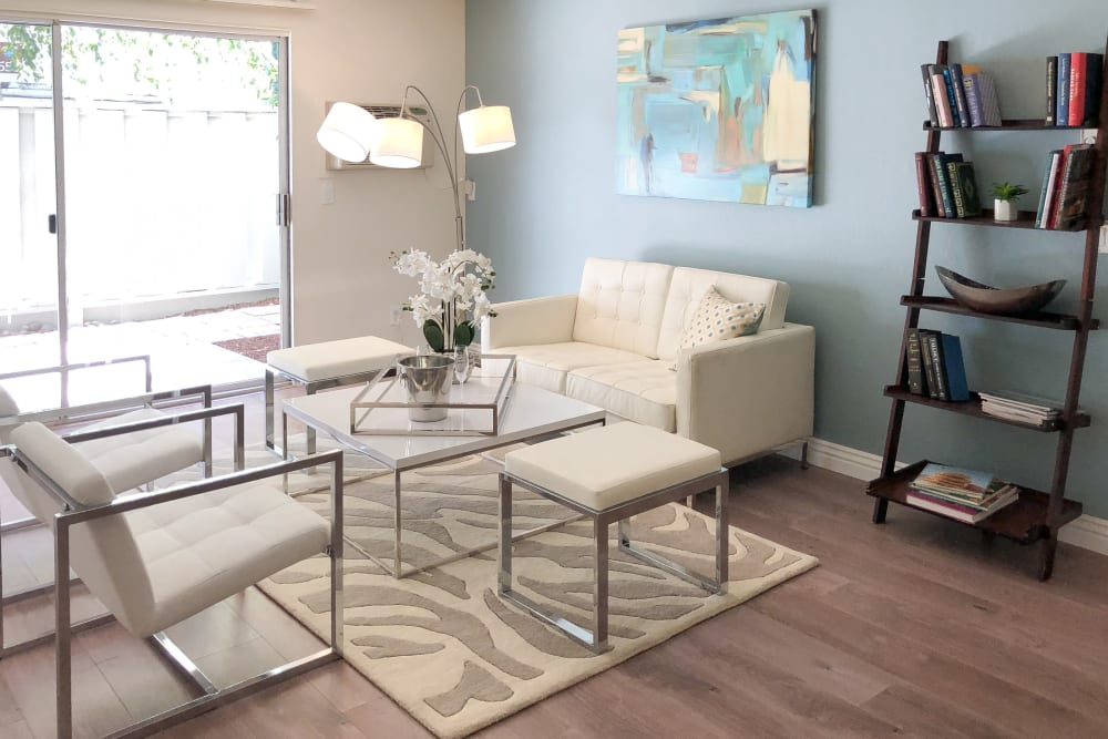 Living room with wood-style flooring at Newport Apartments in Campbell, California