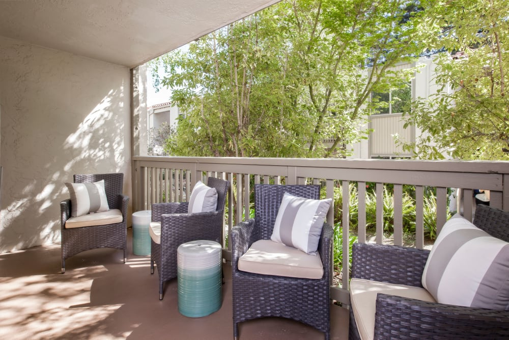 Patio chair on a private balcony at Spring Creek Apartments in Santa Clara, California