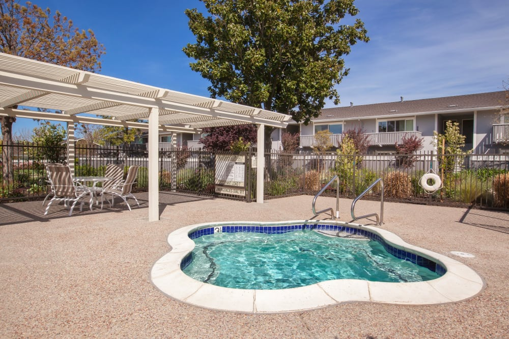 Relaxing hot tub at Village Green Apartments in Cupertino, California