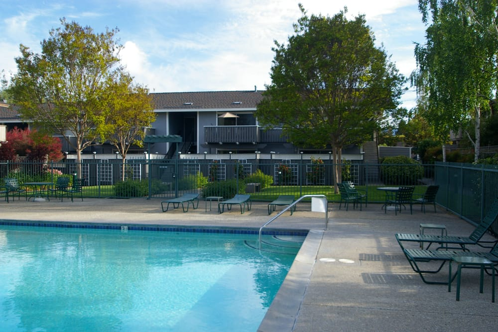 Pool and exterior of Village Green Apartments in Cupertino, California