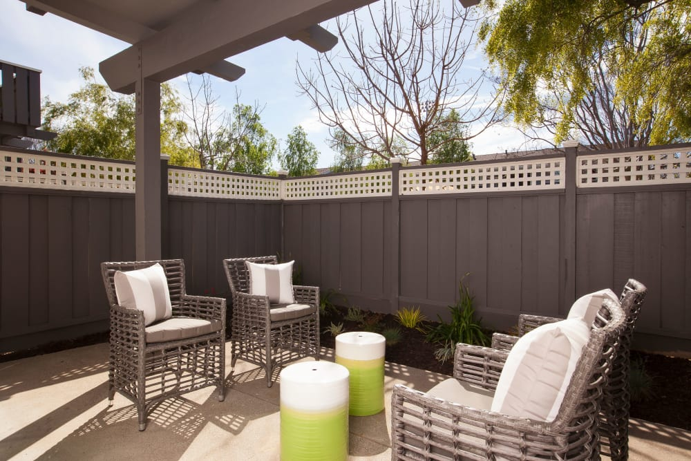 Private patio with furniture at Village Green Apartments in Cupertino, California