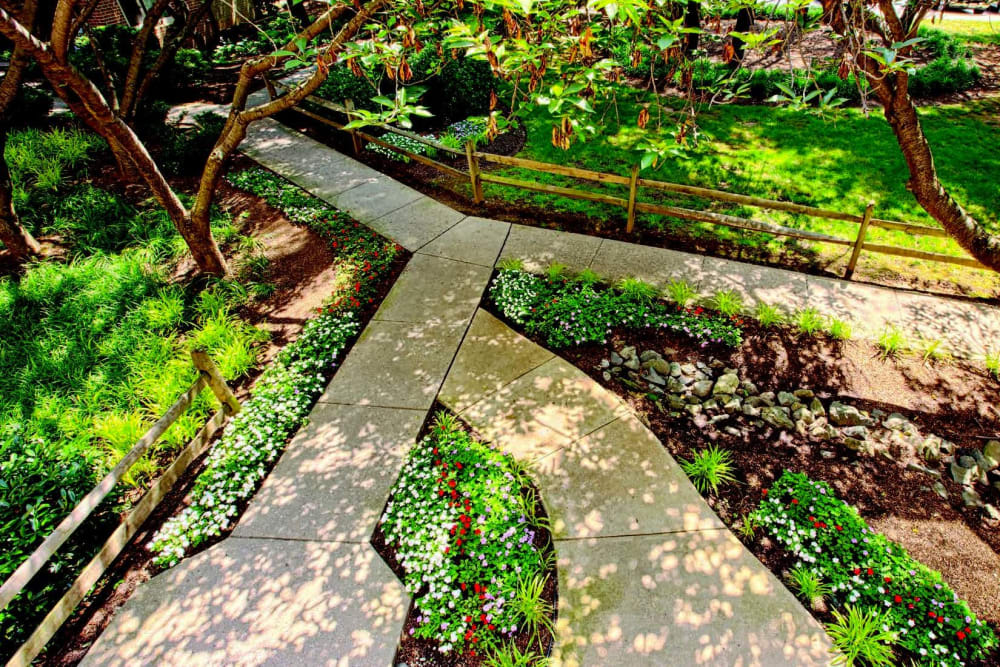 Winding pathways and beautifully maintained landscaping at The Timbers at Long Reach Apartments in Columbia, Maryland