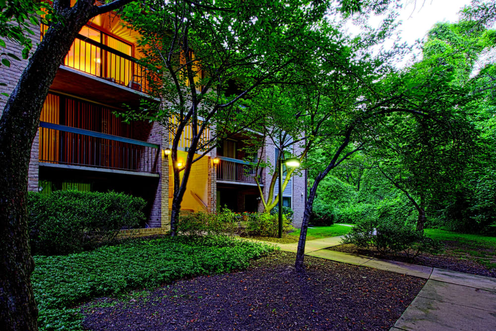Exterior view of resident buildings at dusk at The Timbers at Long Reach Apartments in Columbia, Maryland