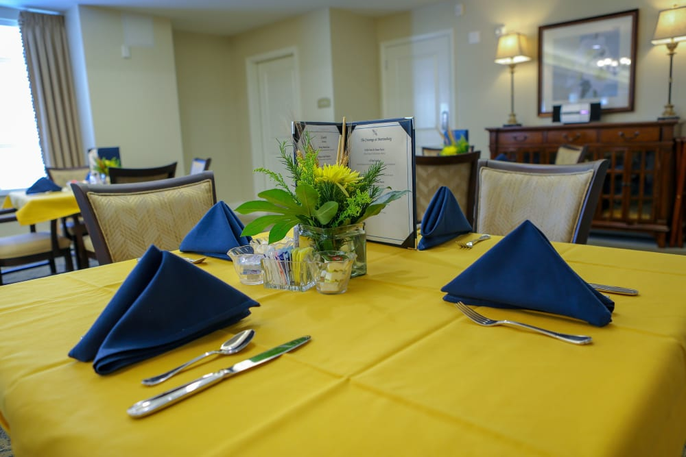 A yellow and blue dinner setting at Harmony at Martinsburg in Martinsburg, West Virginia