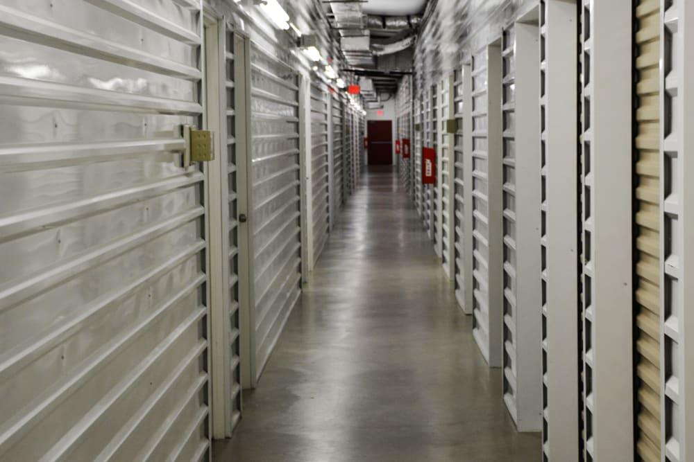 Row of indoor storage units at AAA Alliance Self Storage in San Antonio, Texas