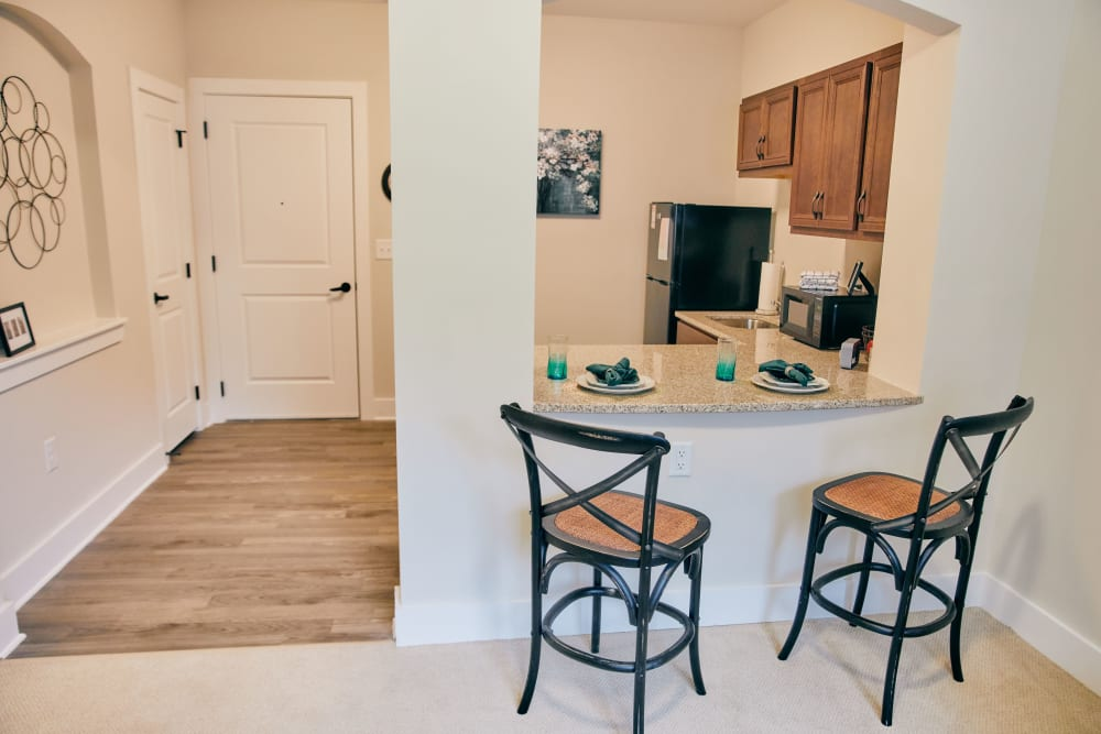 Sitting at the kitchen bar is available at Harmony at West Ashley in Charleston, South Carolina