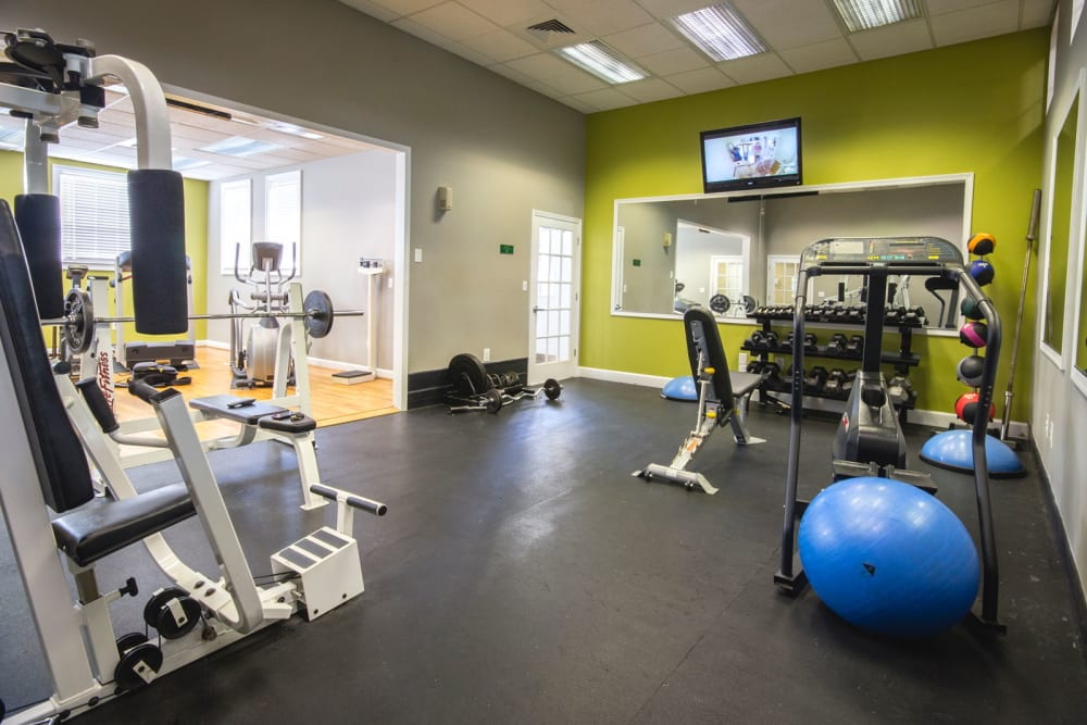 Fitness center with individual workout-stations at Glade Creek Apartments in Roanoke, Virginia