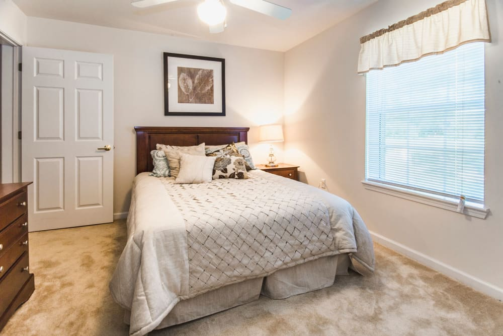 Large master bedroom with plush carpeting at Glade Creek Apartments in Roanoke, Virginia
