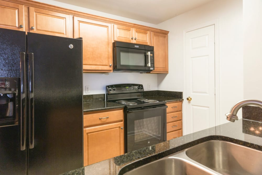 Kitchen with a double stainless-steel sink at Glade Creek Apartments in Roanoke, Virginia