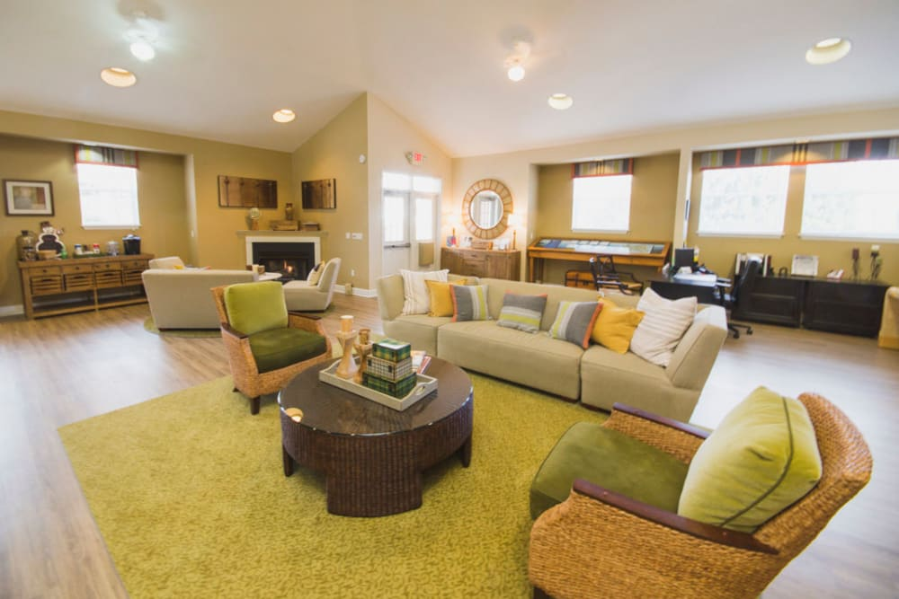 Community clubhouse with comfortable couches at Glade Creek Apartments in Roanoke, Virginia
