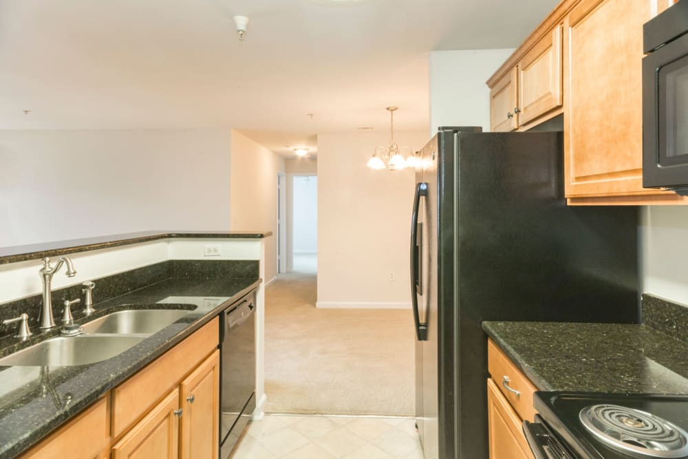 Kitchen overlooking the living room at Glade Creek Apartments in Roanoke, Virginia