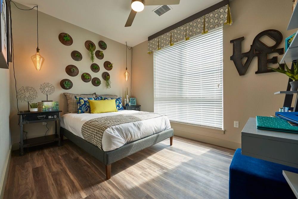 Cozy bedroom at Encore Evans Station in Denver, Colorado