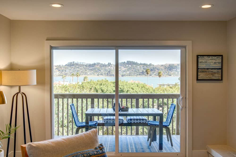 Sliding doors leading to the private balcony outside a model home at Harbor Point Apartments in Mill Valley, California