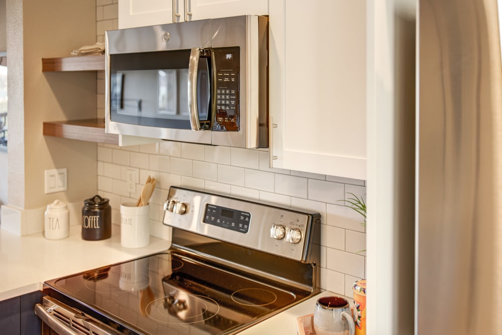 Subway tile backsplash and stainless-steel appliances in a model home's kitchen at Harbor Point Apartments in Mill Valley, California