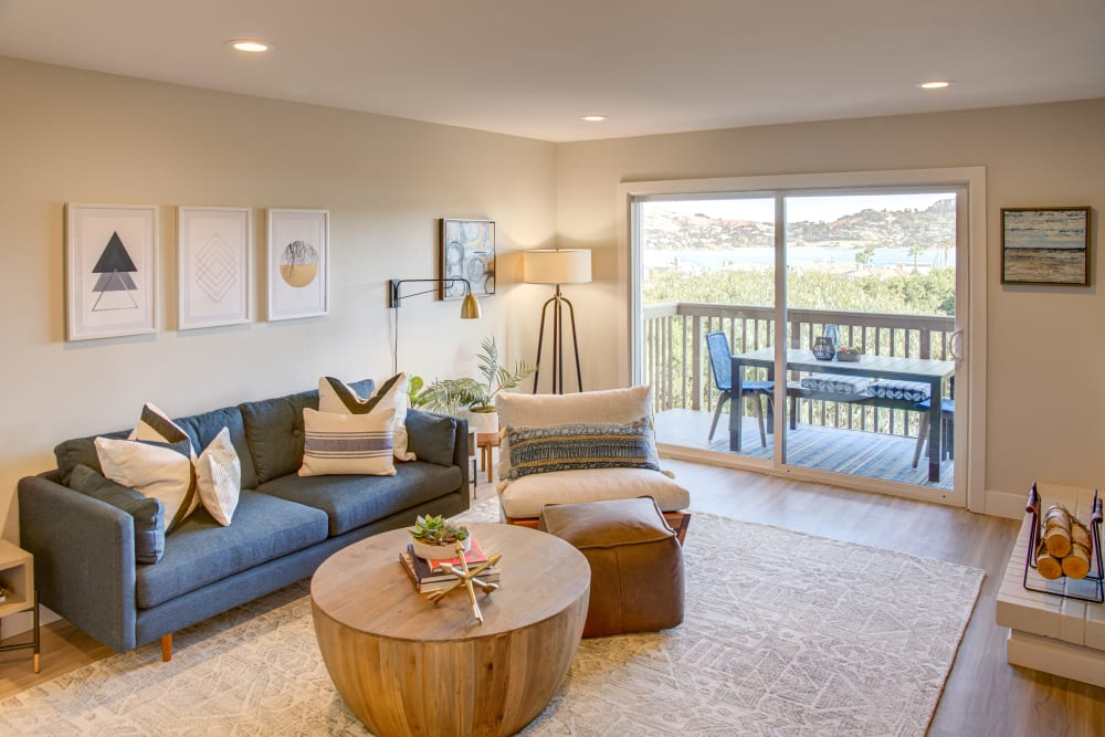 View of the private balcony from a model home's living area at Harbor Point Apartments in Mill Valley, California