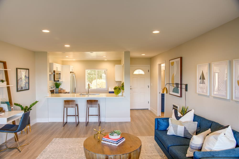 Well-decorated open-concept living space in a model home at Harbor Point Apartments in Mill Valley, California