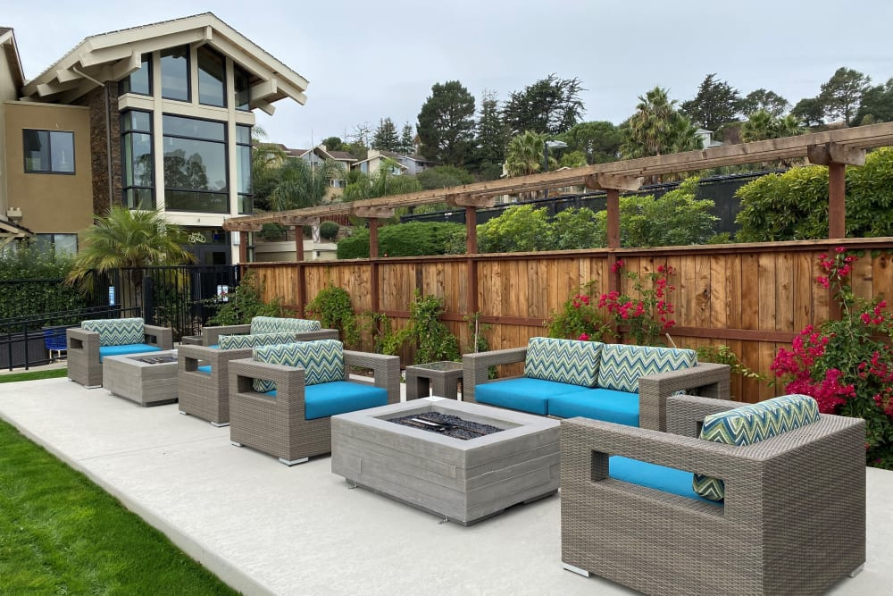 Luxurious outdoor lounge area by the pool at Harbor Point Apartments in Mill Valley, California