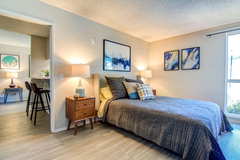 Well-furnished model home's bedroom at Veranda La Mesa in La Mesa, California