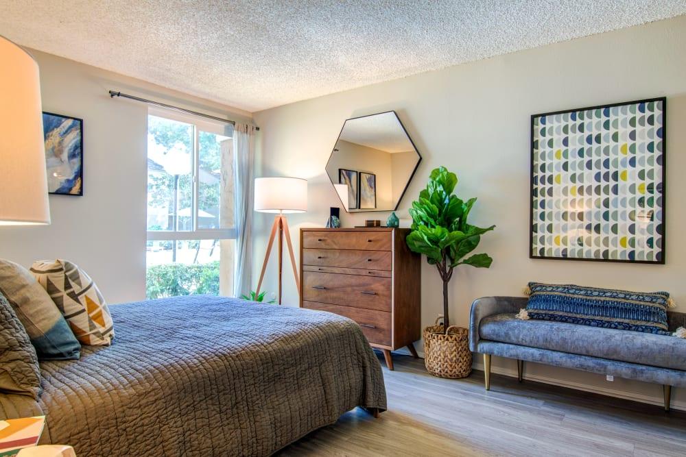 Modern decor in the bedroom of a model home at Veranda La Mesa in La Mesa, California