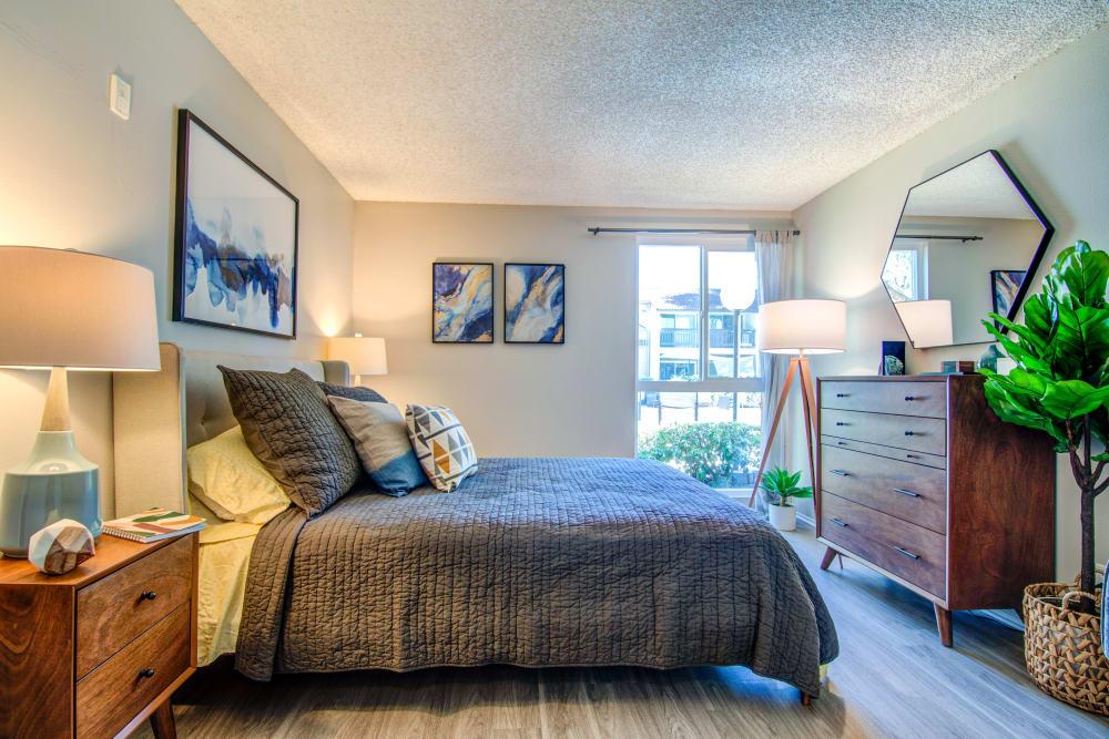 Accent wall and hardwood flooring in a model home's master bedroom at Veranda La Mesa in La Mesa, California