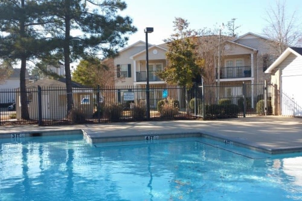 A fenced community pool at Bristol Park Apartments in Jackson, Mississippi