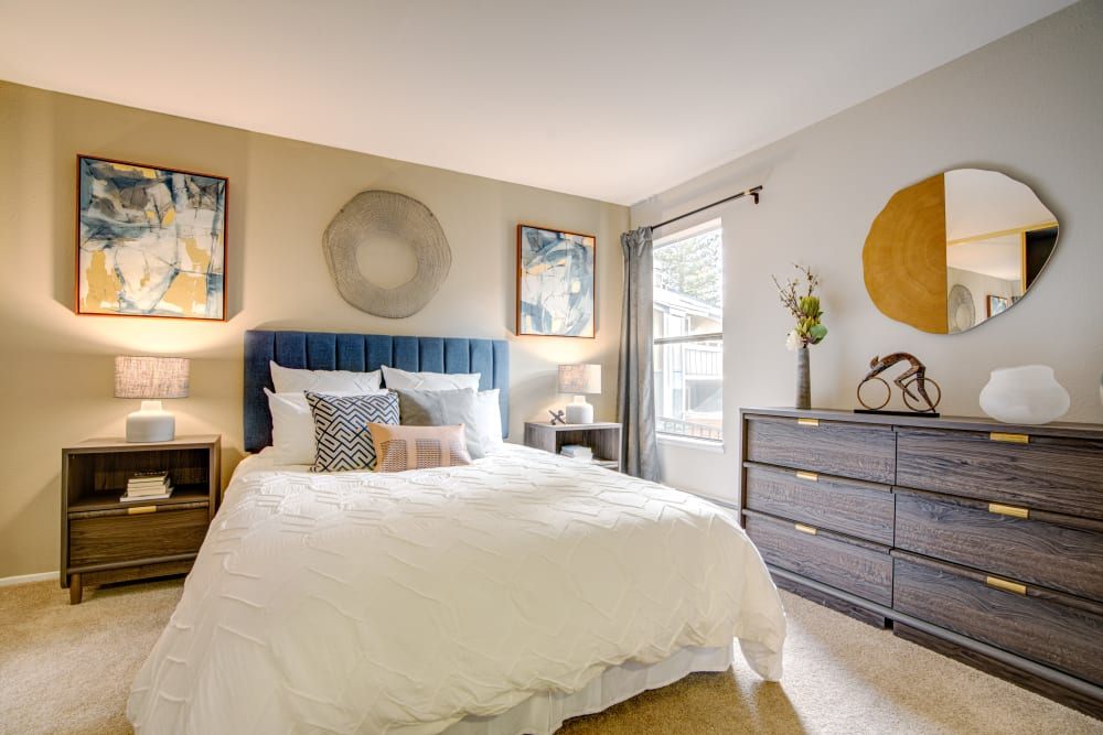 Accent wall and modern furnishings in a model home's master bedroom at Terra Martinez in Martinez, California