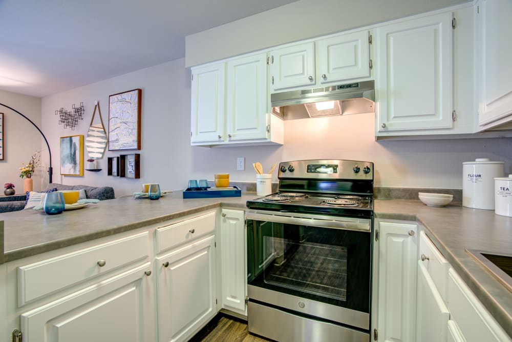 Stainless-steel appliances and granite countertops in a model home's kitchen at Terra Martinez in Martinez, California