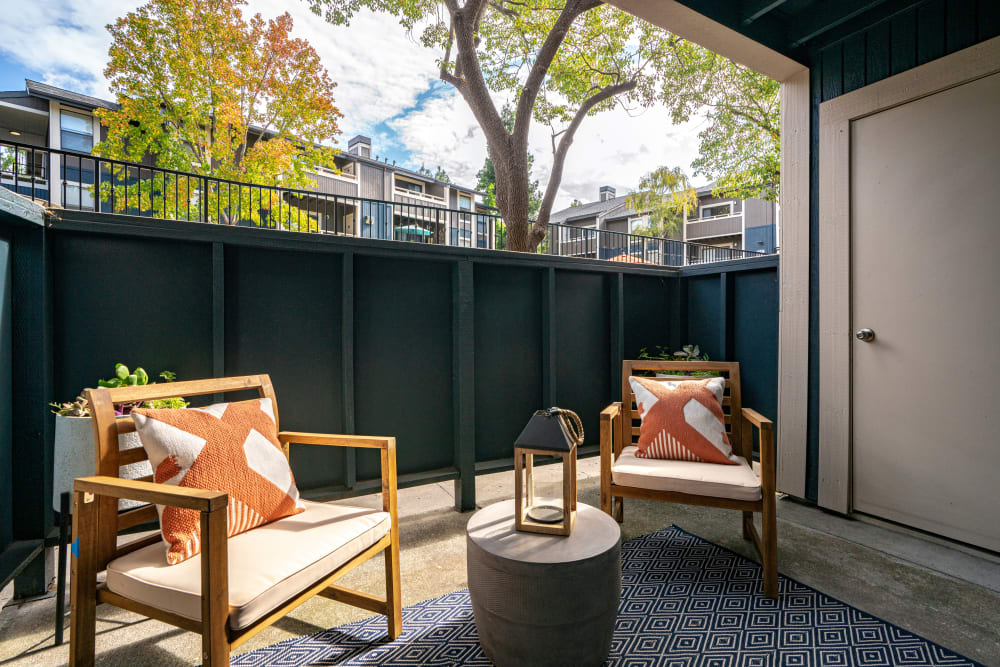 Comfortably furnished private patio outside a model home at Terra Martinez in Martinez, California
