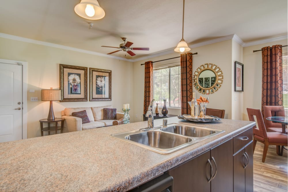 Expansive granite countertops in a model home's kitchen at Broadstone Towne Center in Albuquerque, New Mexico