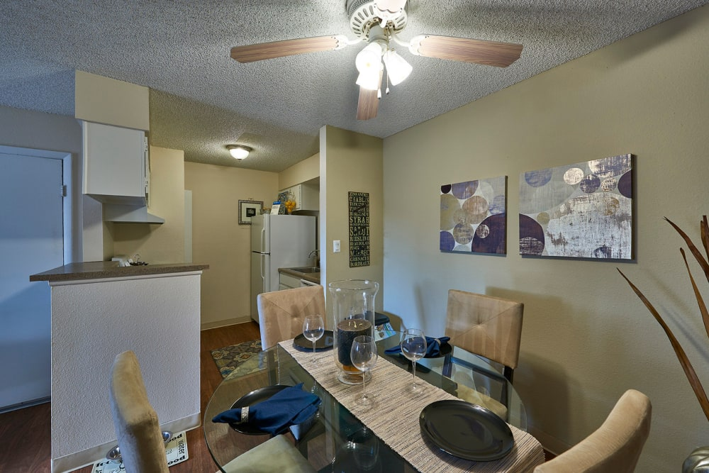 Dining room with a ceiling fan at Hampden Heights Apartments in Denver, Colorado