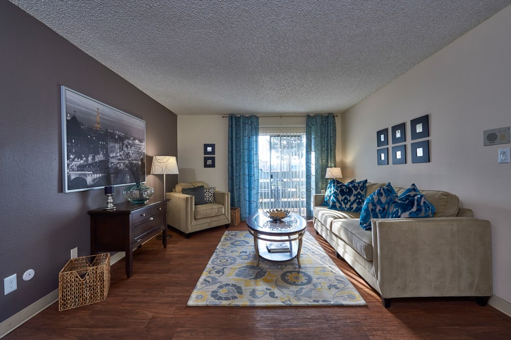 Living room with wood-style flooring at Hampden Heights Apartments in Denver, Colorado