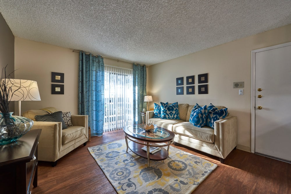 Living room with back patio access at Hampden Heights Apartments in Denver, Colorado