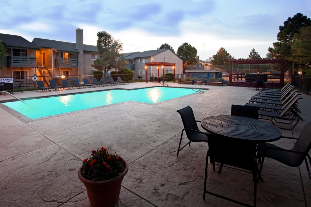 Swimming pool with a large sundeck at Hampden Heights Apartments in Denver, Colorado