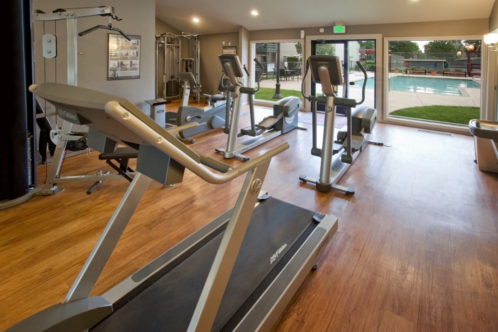 Fitness center next to the swimming pool at Hampden Heights Apartments in Denver, Colorado